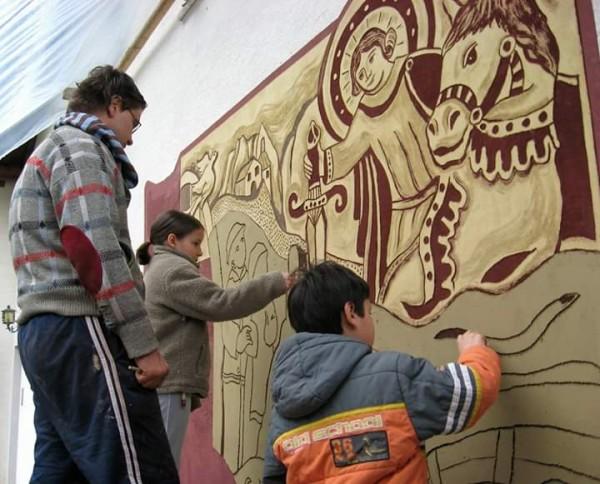 Agordo - Paese del graffito Dunio Piccolin con i bambini e la leggenda di Agordo